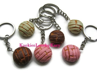 """Keychains shaped bread traditional Mexican """"shells"""" egg bread."""