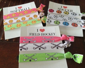 I love softball, soccer or field hockey hair ties. Choose your sport!