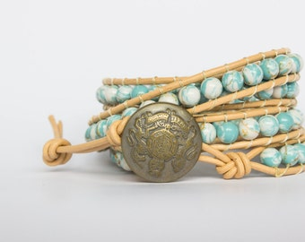 4-wrap bracelet with skyblue paint stones on beige leather cord
