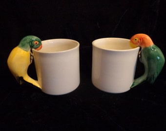 2 Parrot Mugs, Hand Painted Porcelain Parrot White Cups, Parrot Handle Mugs, Figural Parrot Mugs, A Pair Of Polynesian style mugs