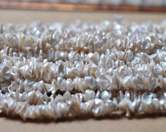 "White Freshwater Keshi Pearl Center Drilled 9-12MM (16"" Strand)"