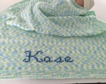 Knitted funny prints baby blanket with monogramming.