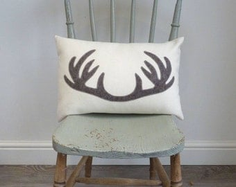 Wool cushion with antler applique