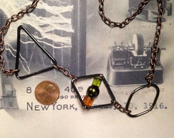 Steampunk geometric and glass bead necklace