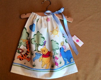 Winnie-the-Pooh baby dress in sizes, 3 month, 6 month, 12 month and 18 month, with pretty blue  ribbon-so cute for a party!