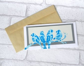 Bird silhouette in pasley print paper in Teal and blue. Unique. Papercraft. Bird silhouette. Free envelope. Greeting cards. Party supply