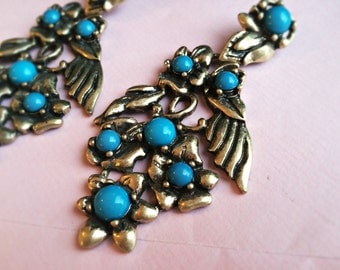Bronze coloured earrings with blue and flashy stones, Angel wings and flowers pattern