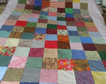 Patchwork multi fabric quilt top