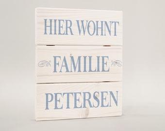Here lives family, door sign door, family