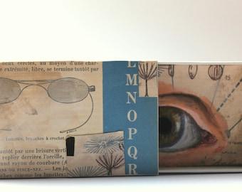 Art box:petit diorama réalisé dans une boîte d'allumette.Cabinet de curiosités.Matchbox.Oeil.Lunettes.