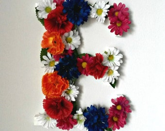 Letter. Decorative letter with fake flowers to hang