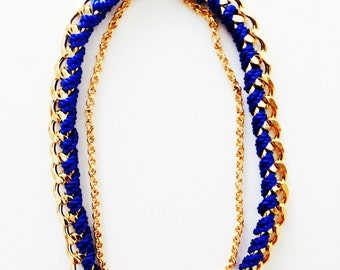 Bracelet blue and gold chain.