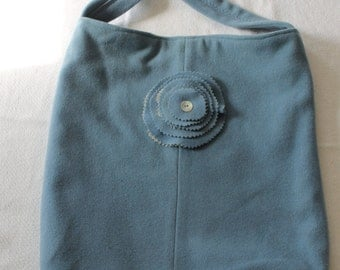 Blue cashmere large rectangular bag with self fabric strap and flower