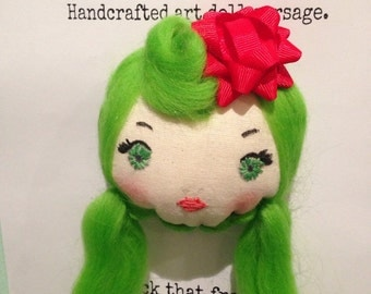 Dollface corsage.  Miss Yule.