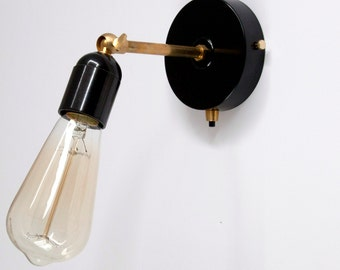 Wall sconce with black Bakelite lampholder and brass joints
