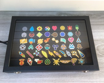 50 Pokemon gym badges in display case