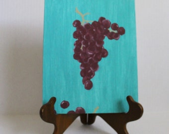 """Grapes - A bundle of shining burgundy grapes on a teal background. 8""""x10"""" Acrylic"""