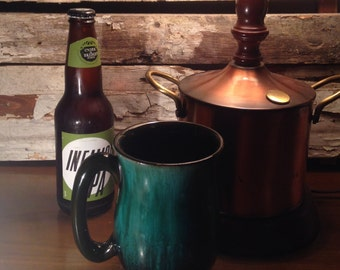 Vintage drip glazed green and black stein/mug: Evangeline pottery