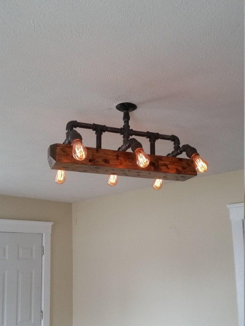 wood beam light chandelier industrial pipe lighting barn wood reclaimed wood rustic light fixture southwestern boho bohemian chandelier barn board