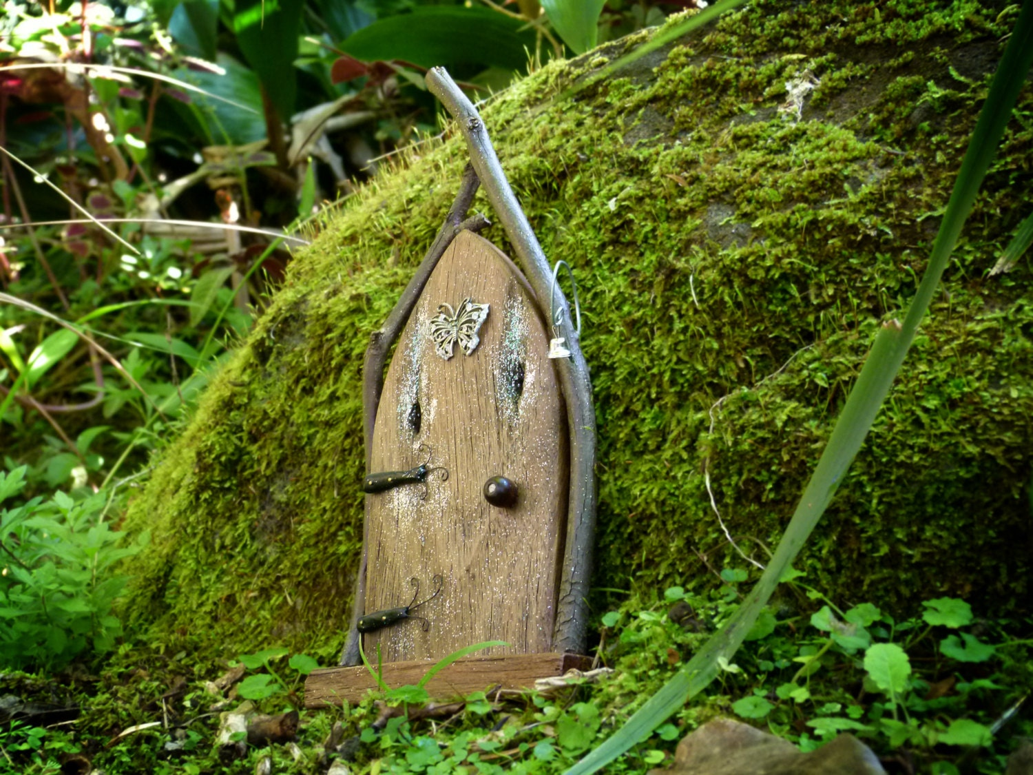 Arched rustic wooden fairy door with twig frame doorbell for Wooden fairy doors