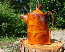 Red teapot flame, faience.