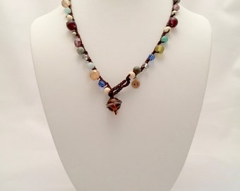 Crocheted beaded necklace, glass bead pendant, lampworked glass