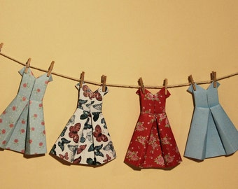 Six different paper dresses