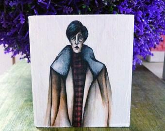 Dressed in Otto Dix-mini illustration on small wooden block