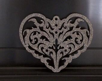Heart shaped trivet made from Corian