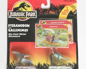 Jurassic Park Die-cast metal dinosaurs. Pteranodom and Gallimimus. Unopened with 2 Collector Cards