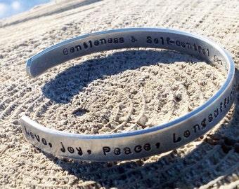 fruit of the spirit hand stamped aluminium cuff bracelet