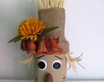Hand-Painted Mason Jar Scarecrow featuring a Handmade Bow