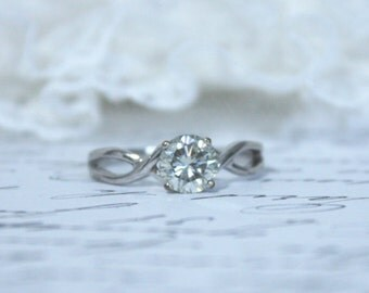 9k White Gold Infinity Style Solitaire Ring With 6.18mm Off-White Moissanite