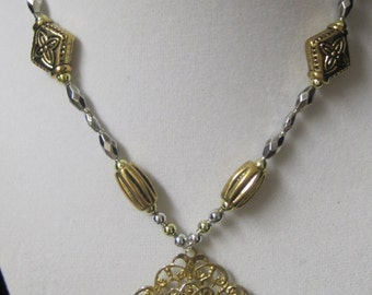 22 inch very Attractive  light weight finished Gold and Silver metal with with Diamond shaped metal Drop.