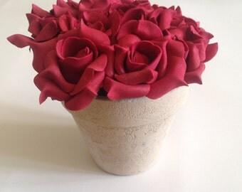 Decorative foam rose bouquet in ceramic pot