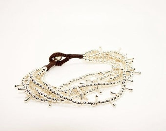 Silver Beaded Multi-strand Bracelet - on wax cord with bell finish