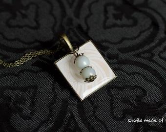 White swirl pendant