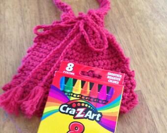 Crayon purse and crayons.