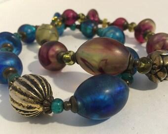 Set of jewel toned beaded swirled bracelets, multi color bracelets, vintage bracelets