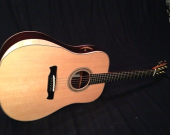 Handcrafted custom built quality solid wood acoustic guitar