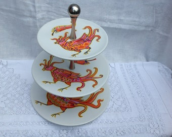 Three tiered ceramic cake stand hand painted with firebirds