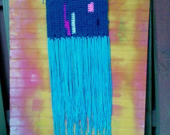 small handmade crochet wall hanging