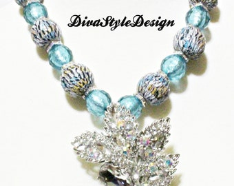 Unique Animal Print Statement Necklace with an Iridescent Flower Pendant