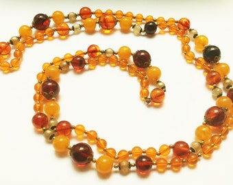 Sparkling vintage necklace with amber brown beads