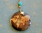 World locket love pendant map globe traveler wanderer necklace graduation gift. Tiedupmemories