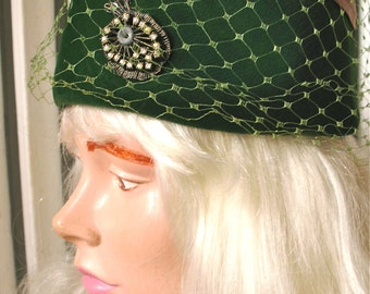 Burnett   Vintage 1960s Green Velvet Pill Box Hat with Veil and Rhinestone Decoration