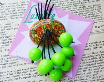 Jungle Boogie!  Zesty Lime green and colourful flecks sparkling 40s 50s confetti lucite style novelty Lime cherry brooch