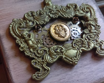 Embellished steampunk jewelry box with vintage button and satin bottom