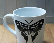 Hand painted coffee mug with traditional butterfly tattoo design!