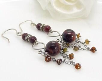 Long dark brown tigers eye and hessonite garnet chandelier earrings in sterling silver